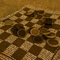 Playing Checkers On A Rug by Mitch Spence
