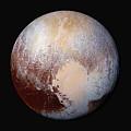 Pluto Dazzles In False Color by Nasa