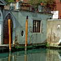 Poles On Canal In Venice by Michael Henderson