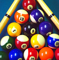 Pool Balls And Cue Sticks by Steve Ohlsen