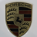 Porsche Emblem On White by Sebastian Musial