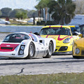 Porsches In The Corner At Sebring Raceway by Tad Gage