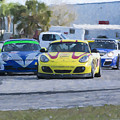 Porsches Rounding The Corner At Sebring by Tad Gage