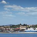 port with ferry boats Corfu Greece by Goce Risteski