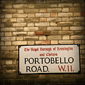 Portobello Road Sign On A Grunge Brick Wall In London England by ELITE IMAGE photography By Chad McDermott