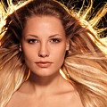 Portrait Of Beautiful Woman Face With Glowing Golden Blond Hair by Oleksiy Maksymenko