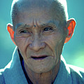 Portrait Of Monk In China by Carl Purcell