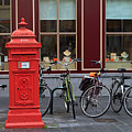 Postbox And Bicycles In Front Of The Diamond Museum In Bruges by Louise Heusinkveld