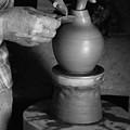 Potter At Work by Gaspar Avila