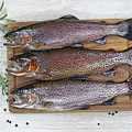 Preparing Trout For Dinner  by Thomas Baker
