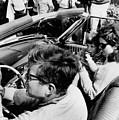 President Kennedy Drives An Open Car by Everett
