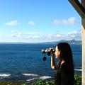 Pretty Girl Looking Through Binoculars by Yali Shi