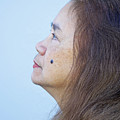 Profile Portrait Of A Lovely Filipina With A Mole On Her Cheek   by Jim Fitzpatrick