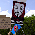 Protesters With An Anonymous Mask by Elzbieta Fazel
