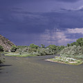 Rain Falls On This Desert Landscape by Stacy Gold