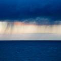 Rain On The Horizon At Strumble Head by Ian Middleton