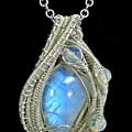 Rainbow Moonstone And Sterling Silver Wire-wrapped Pendant With Ethiopian Welo Opals - Mnstpss11 by Heather Jordan