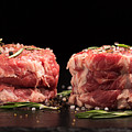 Raw Steak Meat On The Dark Surface by Vadim Goodwill