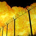 Realistic Fiery Explosion Behind Restricted Area Barbed Wire Fence by Lukasz Szczepanski