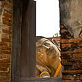 Reclining Buddha View Through A Window by Ulrich Schade