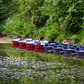 Red And Blue Boats On The River Coquet by Louise Heusinkveld