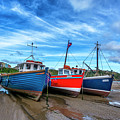Red And Blue Fishing Boats Tenby Port by Tsafreer Bernstein