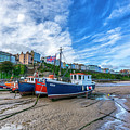 Red And Blue Fishing Trawler In Low Tide by Tsafreer Bernstein