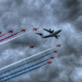 Red Arrows And A400m Airbus by Nigel Bangert
