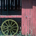 Red Barn And Wagon Wheel by D'Arcy Evans
