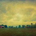 Red Barn Under Stormy Skies by Don Schwartz
