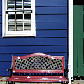 Red Bench Blue House by Iris Posner