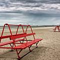 Red Bench On A Beach by Jukka Heinovirta