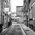 red brick buildings in narrow back turner street Northern quarter Manchester uk by Joe Fox