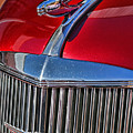 Red Chevrolet Grill And Hood Ornament by Randy Harris