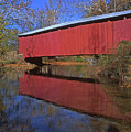 Red Covered Bridge And Reflection by Blair Seitz