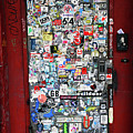 Red Doorway With Stickers by Rick Selin