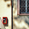 Red Fire Box With Window, Shadows And Gutter by Silvia Ganora
