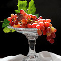 Red Grapes On Glass Dish by Jeannette Scranton