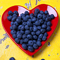 Red heart plate with blueberries by Garry Gay