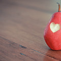 Red Pear With Heart Shape Bit by Danielle Donders - Mothership Photography