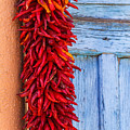 Red Peppers And Blue Door by Steven Bateson