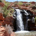 Red Rock Waterfall  by Christy Pooschke