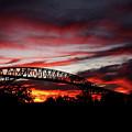 Red Skies At Pleasure Island Bridge by Judy Vincent