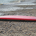 Red Surf Board On A Rocky Beach by DejaVu Designs