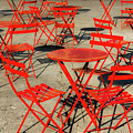 Red Tables And Chairs by Javier Flores