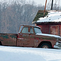 Red Truck In The Snow by David Arment