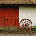 Red Wheel And Barn In Sweden by Greg Matchick