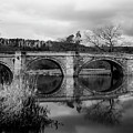 Reflecting Oval Stone Bridge In Blanc And White by Dennis Dame