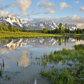 Reflection In Snake River At Grand Teton by Ray Mathis