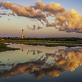 Reflection Of Clouds And Lighthouse by Nick Zelinsky